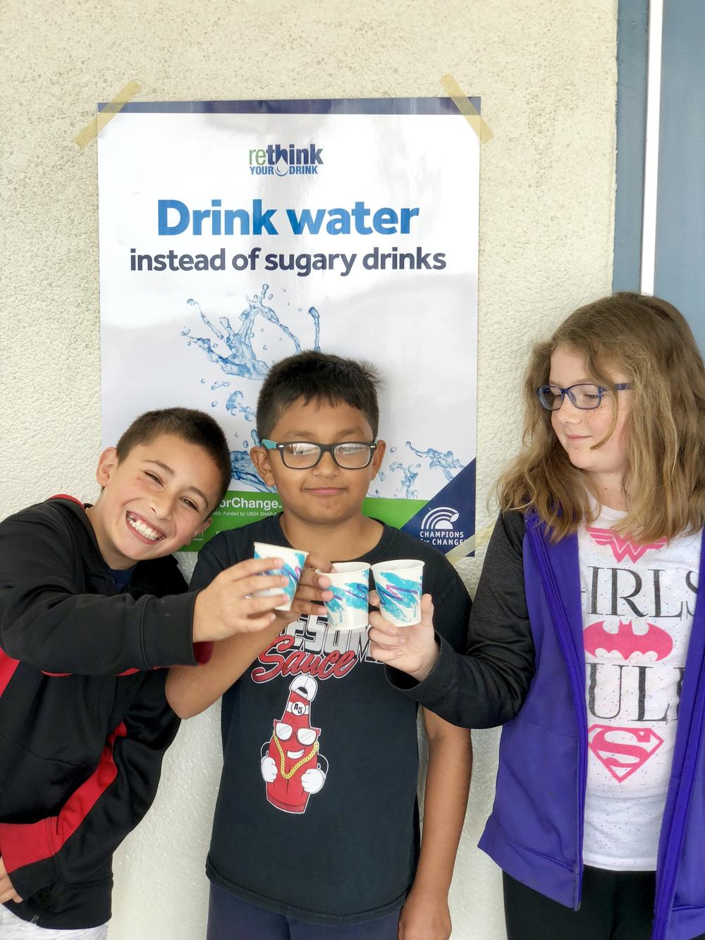 students drink water